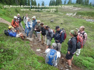 Doug McKeever (orange jacket, left) discusses ash from Crater lake caldera in trail cuts along Scott Paul Trail. Nobody sleeping yet!