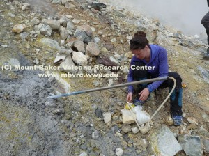 Volunteer Laura collects fumarole gas at Sherman Crater in 2012.