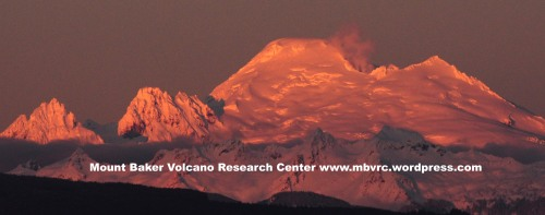 Sherman Crater plumes from Big Lake Washington.Photo courtesy Chris Farrow.