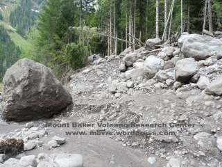 This 14' high boulder was deposited by the 5/31 flow. Photo taken 6/5. Compare with next photo.