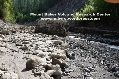 Between June 5th and June 9th, erosion revealed that the 'mound' was a 12' tall boulder.