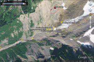 Teminus of the Deming Glacier. Yellow lines mark glacier retreat. The glacier is largely buried by rubble in this view. The landslide scarp is shown. This is a 2011 Google Earth image.