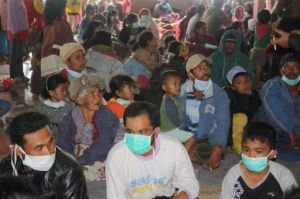 Sinabung residents wear dust masks.